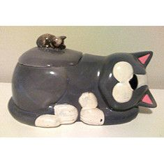"This cookie jar is very reminiscent of the 50's but has a copyright mark on the bottom of 1987. The mouse knob on the lid adds a great whimsical touch. It measures 9-1/2""L x 5-1/2""W x 5""H. No signific"