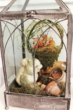 lantern with some little clay pots, leaves, moss basket, squirrel