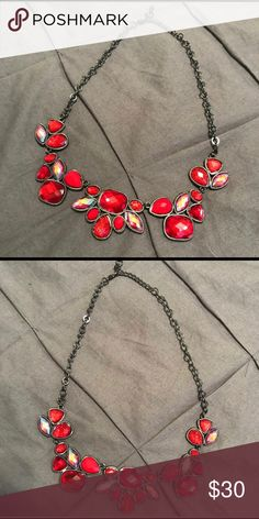 Beautiful red Statement Necklace Beautiful statement piece. No signs of wear. Red stones, Oval stones do have a slight rainbow/iridescent look to them. Adjustable length. Dark silver color. Macy's Jewelry Necklaces