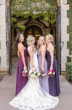 Bridesmaids in assorted purple shades of lilac, lavender and royal purple with long flowing gowns | Monique Hessler Photography | villasiena.cc