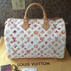 Limited Edition Louis Vuitton Watercolor Speedy 35 This gorgeous Limited Edition Louis Vuitton Watercolor Speedy 35, is a collaboration between Marc Jacobs and Richard Prince.  It is a part of the Spring-Summer 2008 collection.  This bag is in new condition used twice with tags booklet and its original dust cover.  This bag is a part of my personal collection and has been stored in its original dust bag, in a smoke free environment.   This is a major collectors piece absolutely stunning…