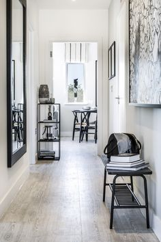 Light and airy hallway with accents of black created by Artspace Interior  Design Ltd