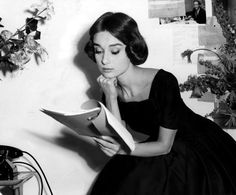 "Audrey Hepburn with her copy of the script on the set of ""Love in the Afternoon""//"