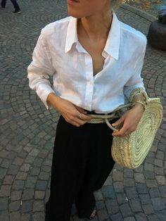 Crisp white shirt. Relaxed black trousers.