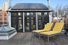 """Penthouse roof extension with solar panels at our brownstone """"gut"""" renovation project."""