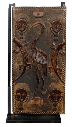 Africa | Granary door from the Ivory Coast | 20th century | Wood.  | posted at www.africacrafttrust.org.za