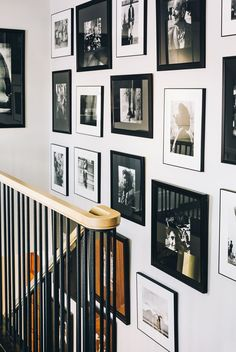 """The black-and-white gallery running up the stairwell is a collection of work by my great-uncle on my father's side Leon Levinstein adds Karu of the home's second gallery wall. """"I'm fortunate to come from long lines of creative people. Gallery Wall Staircase, Gallery Walls, Picture Wall Staircase, Gallery Frames, Interior Exterior, Interior Design, Design Art, Collage Design, 25 Beautiful Homes"""