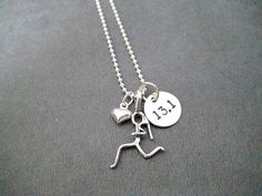 The Run Homes GIRLS LOVE TO RUN 13.1 Half Marathon with HEART Sterling Silver Necklace features a 1/4 inch sterling silver puffed heart , a 1 inch long sterling silver running girl figure with pony tail plus a 7/16 inch (just under 1/2 inch) wide 22 gauge (thicker than standard jewelry making discs) sterling silver disc hand stamped with 13.1 in the center. Choose 16, 18 or 20 inch 1.5 mm Sterling Silver Ball Chain with spring ring clasp. Want to add a DISTANCE? Add a DISTANCE Charm below…