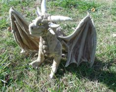22 pages includes illustrated instructions,detailed materials list and full size pattern to make a long Draco as pictured. Printable on regular size printer paper Suitable for an adult collector to an older child. He is fully wired and pose able. Smaug Dragon, Dragon Art, Baby Patterns, Sewing Patterns, Knitting Patterns, Fantasy Play, Dragon Pattern, Homemade Costumes, Plush Pattern