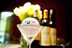 Wine and baseball :).......the occasional cocktail.  Love this picture.