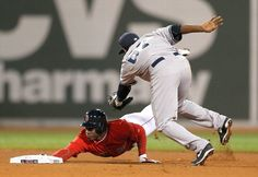 BOSTON, MA - SEPTEMBER 26: Rusney Castillo #38 of the Boston Red Sox scrambles back to second base as Jose Pirela #67 of the New York Yankees attempts to apply the tag in the fifth inning at Fenway Park on September 26, 2014 in Boston, Massachusetts. (Photo by Jim Rogash/Getty Images)