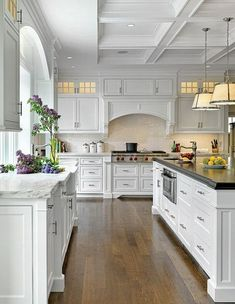 white-kitchen - rethinking white cupboards - at least I'd know if they needed wiping. Don't care for the 2 different colors of counter. The glass fronted cabinets way up high might work. At least no one could see into them to see if they needed dusting....