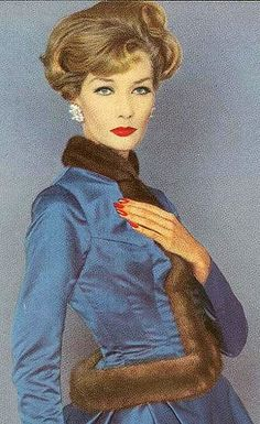 Jessica Ford wearing mink trimmed satin jacket, 1959