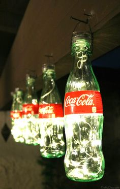 Coca-Cola Bottle Lights (pic only). Use soda or beer bottles to decorate a fam. Coca-Cola Bottle Lights (pic only)… Use soda or beer bottles to decorate a family game room, man Coca Cola Party, Coca Cola Decor, Glass Coke Bottles, Coca Cola Bottles, Empty Bottles, Soda Bottles, Bottle Vase, Anniversaire Pin Up, Garrafa Coca Cola