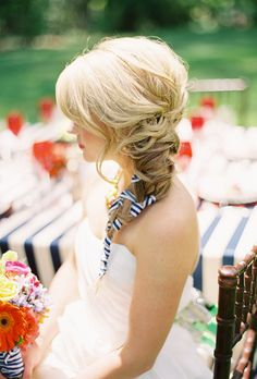 Brides.com: 21 Wedding-Ready Braids. Fishtail Braid with Ribbon Accents  A voluminous fishtail braid can be dressed up for a more playful 'do. Here, a bride intertwined blue-and-white stripe ribbon to play off her weddings nautical vibe. Limit ribbon to just the end of the bride, like this bride does, so it doesn't overwhelm the style.    See more wedding updos.