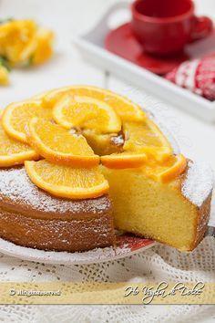 Torta all'arancia e yogurt sofficissima e facile da preparare.Un dolce morbido e senza burro. Ricetta veloce e genuina per la colazione e merenda.
