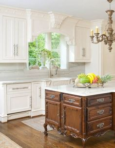 "The is a VERY BEAUTIFUL kitchen. ""This kitchen appears a bit simple until one notices all the detail in the ornate crown moulding, corbels, and antique style center island"""