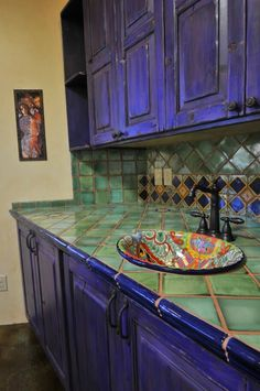 Like the combination of solid and patterned tiles with the talavera sink.