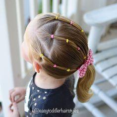Simple toddler elastic hairstyle.  Fun colors!  #hairideas #hairforgirls #littlegirlhair