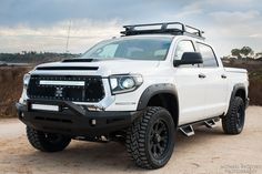 Magnum Bumper for the 2014 Toyota Tundra (pictured with RT-Series Light Bar). Toyota Tundra Lifted, 2015 Toyota Tundra, Tundra 2015, 2015 Ford F150, Tundra Truck, Truck Mods, Car Insurance Rates, Toyota Trucks, Truck Accessories