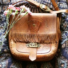 Beautiful and unique VINTAGE LEATHER BAG - Shop it before it is gone forever ✌ www.shittyfucky.com #shittyfucky #onlineshop #vintage #hippiebag #leatherbag #bohobag #bag #fringebag #hippie #boho #gypsy #festivalstyle #festivalbag #ootd #accessories #grunge #aesthetics #alternative #flowers #inspiration #peace #vintagelover #truevintage #hippiestyle #70s #folk #wanderlust #summer #goodvibes #festivalfashion