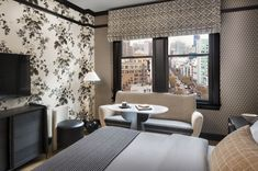 The interior design style of the San Francisco Proper hotel guestrooms features a mix of vintage and contemporary furnishings, custom patterened wallcoverings inspired by vintage European graphics, and commissioned geometric art pieces by local artists Joe Ferriso and Jonathan Anzalone. Tap the pin for more hotel room design ideas.