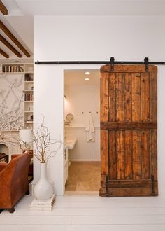 Salvaged Sliding Barn Door by The Brooklyn Home Company / http://www.thebrooklynhomecompany.com/portfolio/5th-street/