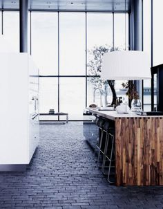 brick floor kitchen. im loving this! it totally brings the outside in, especially with that glass front.