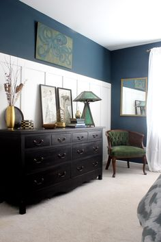 Master bedroom tour: walls are Benjamin Moore's Newburg Green....lots of vintage finds and a hand painted octopus