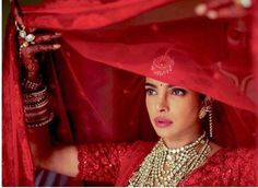 Priyanka Chopra is casting spells in her red lehenga during her Hindu wedding - Times of India ► Red Lehenga, Sabyasachi Lehenga Cost, Sabyasachi Bride, Bridal Lehenga, Lehenga Choli, Bridal Mehndi, Sarees, Nick Jonas, Bridal Looks