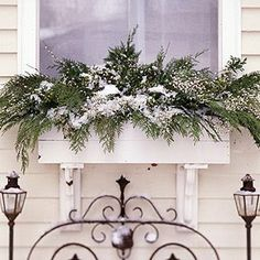 Great winter or Christmas window box idea. Here is a window box with evergreen swags or branches. Again, the natural snow on top of the greens is a lovely touch.