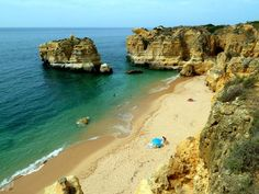 Sao Rafael, a picturesque beach in Faro, Portugal, with golden sand and turquoise water