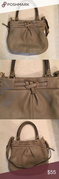 """Gianni Bini Leather Satchel Gray leather satchel with black and gold accents. The shorter straps can be worn over the shoulder or carried as a handbag. The longer, removeable strap can create a longer shoulder bag or a cross body. No cosmetic damage! Like new! 14"""" wide by 13"""" deep. No trades. Reasonable offers accepted. Gianni Bini Bags Shoulder Bags"""