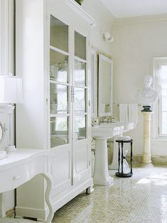 The Unfitted Bath - using individual pieces of furniture rather than built-in cabinetry to avoid a cookie-cutter look. Love the antique French bibliotheque!