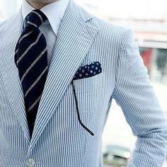 Seersucker jacket, white shirt, navy tie with light grey stripes