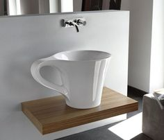 Cup Wash Basin - $3800 / This sink in the form of a cup is made of ceramic and goes great in any modern bathroom. Cup Wash Basin by Meneghello Paolelli. http://thegadgetflow.com/portfolio/cup-wash-basin/