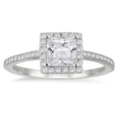 Impress the love of your life with this diamond halo engagement ring. This gorgeous ring features a hefty princess cut 3/4 carat center stone that is flanked by 42 side stones for a total diamond weig