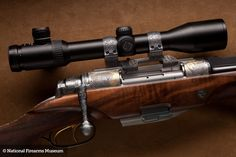 This unique double barrel bolt-action rifle is quite radical in design. It loads two cartridges at the same time and is the world's only repeating double rifle design.  Incorporating titanium components to reduce weight, this .416 Remington Magnum rifle has an eight-shot capacity, feeding from a beautifully engraved massive magazine assembly mounted under the receiver. Hungarian inventor Joseph Szecsei developed his innovative design after being charged simultaneously by three elephants in…