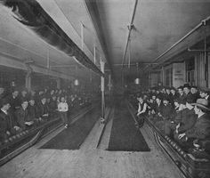 This photo, taken in Worcester about 1906, shows the huge crowd sitting to watch a match between Billie Winch and a man named Wray. A few interesting side notes. Notice the rolled up curtain. This was lowered when ladies bowled, which wasn't often. Also notice that the spectators are dressed in their Sunday best. The haze that causes the photo to appear blurred down the lane is actually smoke filling the room, no doubt from the crowd. The lanes were made of a darker wood.