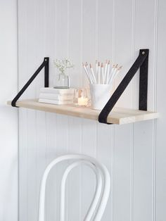 Add interest to plain walls with this on-trend contemporary hand-crafted shelf with black supports.