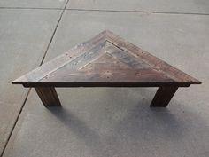 Triangular coffee table made out of pallets for daughter.