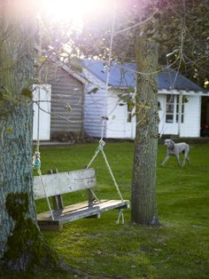 I'd love to add a swing like that to my garden