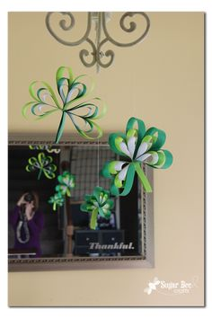 a tutorial on Paper Strip Shamrocks – yeah, you probably saw this coming…. because I had Paper Strip Ornaments hanging all through the holidays, then I went with Paper Strip Hearts, and when they came down it felt empty – like I needed something hanging over my dining room table. UPDATE: I now have a …