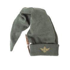Top off your cosplay with the Legend of Zelda Link Beanie Hat with Brown Buckle. Look like everyone's favourite hero with this long pointy elfish beanie measuring in length. The beanie has an golden embroidered crest and a brown strap with buckle. Zelda Logo, The Legend Of Zelda, Link Zelda, Hades, Beanies, Beanie Hats, Legend Of Zelda Merchandise, Anime Merchandise, Jersey Retro