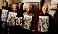 "Europe Reckons With Its Legacy of Communism:  Anti-Communist protesters hold pictures of people who lost their lives under martial law in Poland.  A court in Poland last month (Jan. 2012) found that the Communist leaders behind the imposition of martial law in December 1981 were part of a ""criminal group."""