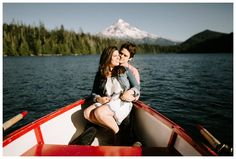 Engagement photos in a row boat on Lost Lake on Mt. Hood, taken by Katy Weaver Photography