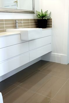 dark floor tiles and above vanity with white walls Like this tile for the living area.