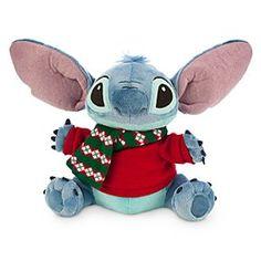 Disney Stitch Plush - Holiday - Medium - 12''   Disney StoreStitch Plush - Holiday - Medium - 12'' - ''Share the Magic'' of a Big Island mountain holiday with our soft-stuffed Stitch Plush, dressed in his seasonal best: a warm knit sweater, plus matching plaid muffler. Lilo will love it!