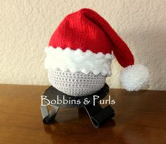 Christmastime is here! This hand-knit Santa cap with cable/picot band and pompom tail is an adorable addition to your little ones Christmas