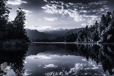 size: Photographic Print: Lake Matheson at Sunrise with Mount Cook on Right Center and Mount Tasman on Left Center by Michael Melford : Travel Around The World, Around The Worlds, New Zealand Adventure, Mount Cook, Photo Calendar, Framed Artwork, Find Art, Sunrise, Photography